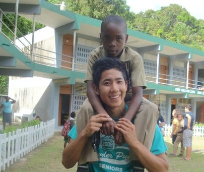 "In true ""he's not heavy, he's my brother"" fashion, Yoshi Okabe hangs out with his ""main man, JJ,"" during a church mission to Jamaica last year."