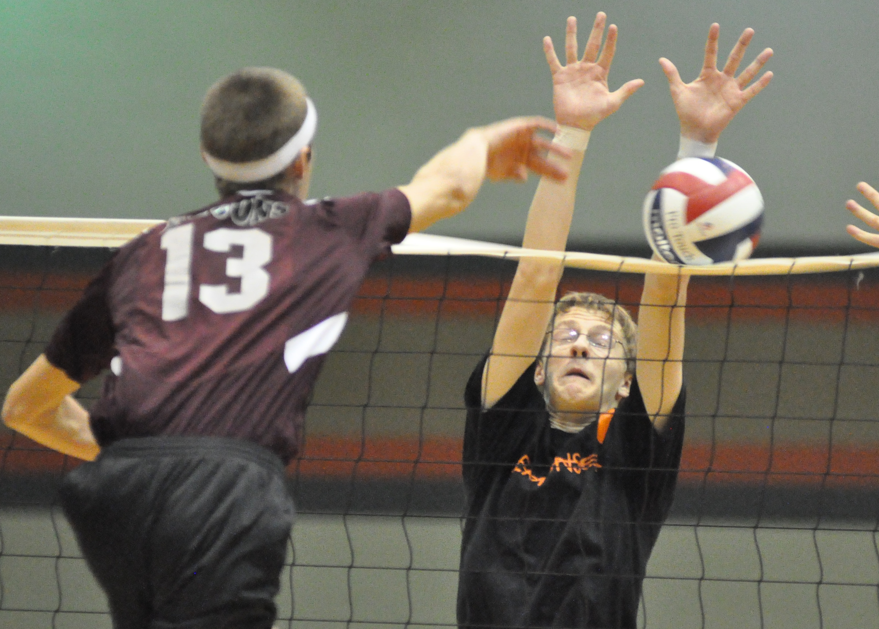 Burlington's Nick Bartlett blocks a spike attempt by a Westosha Central player during Thursday's sectional match at BHS. (Photo by Ed Nadolski)