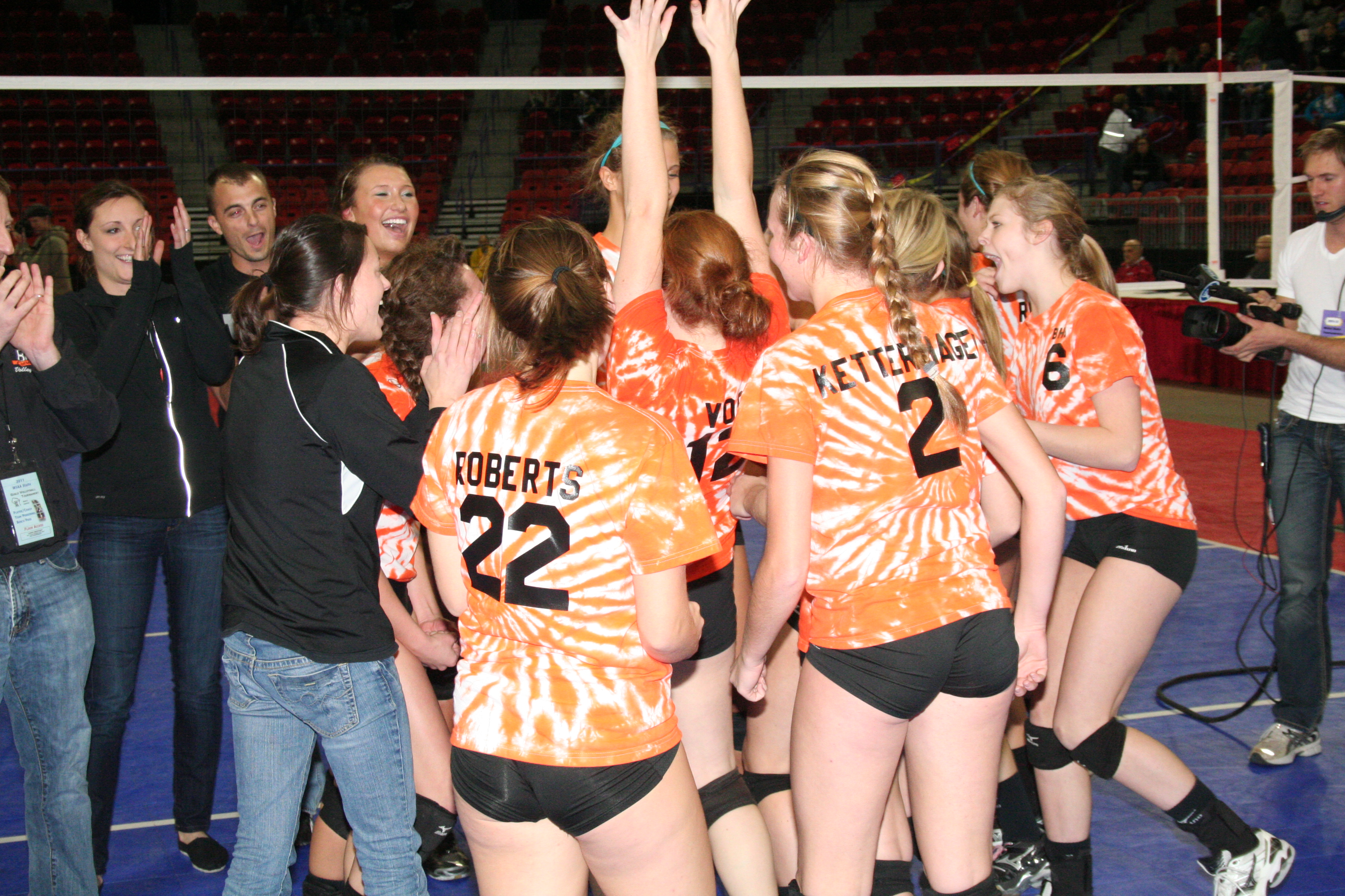 Members of the Burlington High School girls' volleyball team celebrate after winning the WIAA Division 1 state title Saturday night. (Photo by Jennifer Eisenbart)