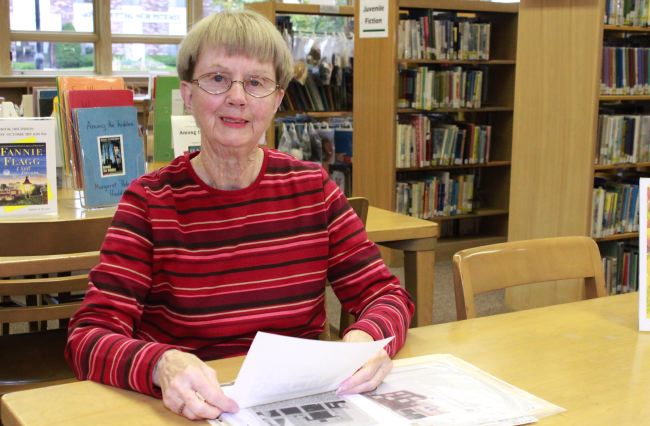 Graham Public Library volunteer Betty Backus pages through the history files at the library – a volunteer project she has been working on for about 15 years. Backus recently received the Wisconsin Library Association's 2011 Citation of Merit Award for her volunteer work.  (Photo by Julie Rossman)
