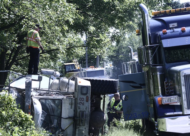 Concrete mixer tips over on Highway 11