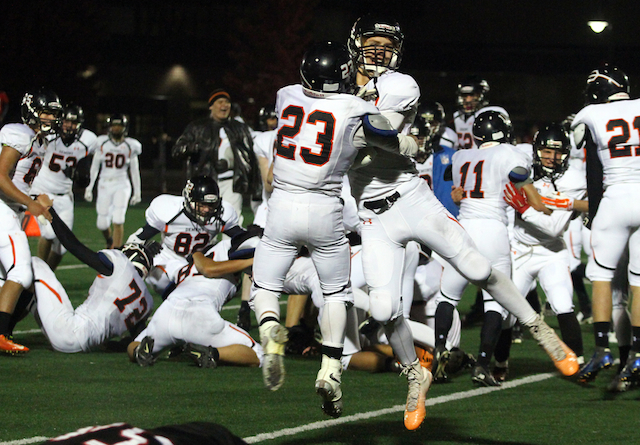 Burlington wins 4-OT thriller, clinches share of conference title