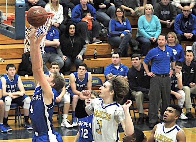 Heiligenthal surpasses 1,000-point plateau in Catholic Central's third straight win
