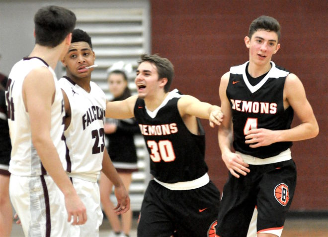 Working overtime: Late comeback catapults Burlington basketball into first place