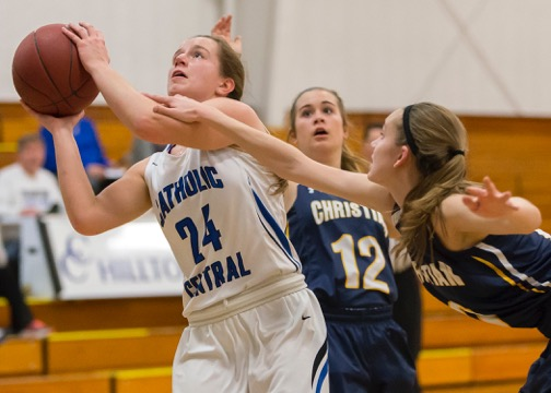 Catholic Central sails in playoff basketball opener