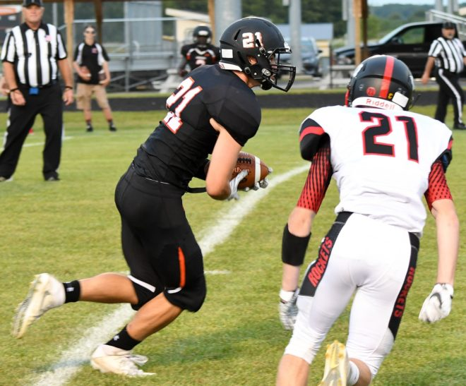 Burlington holds on to win football opener, Catholic Central falls