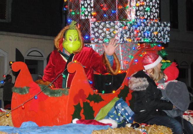 Parade-goers embrace the spirit of Christmas