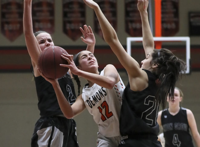 Short-handed Burlington basketball upset on buzzer beater, title hopes crushed