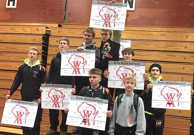 Burlington wrestling cruises to regional title behind 8 champions