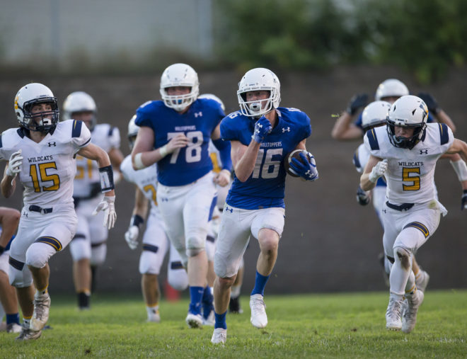Catholic Central grits way to first football victory since 2016