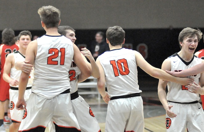 Boys basketball: Demons pick up first win