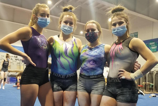 Near-perfect effort sends gymnasts to state